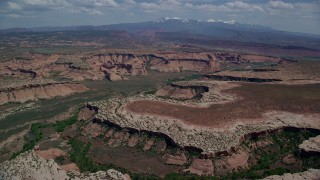 AX137_056 - 6K stock footage aerial video of flying by the Salt Wash Canyons, Arches National Park, Utah
