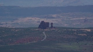 AX137_059 - 6K stock footage aerial video of Balanced Rock and Arches Scenic Drive at Arches National Park, Utah
