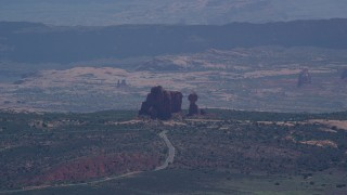 AX137_060 - 6K stock footage aerial video of a view of Balanced Rock and Scenic Drive, Arches National Park, Utah