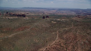 AX137_064 - 6K stock footage aerial video of flying by Ham Rock and Balanced Rock near Arches Scenic Drive, Arches National Park, Utah