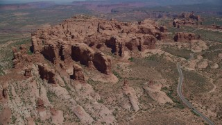 AX137_070 - 6K stock footage aerial video approach Elephant Butte and Double Arch rock formations, Arches National Park, Utah