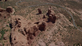 AX137_072 - 6K stock footage aerial video of a bird's eye and orbit of Elephant Butte on Double Arch, Arches National Park, Utah