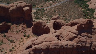 AX137_073 - 6K stock footage aerial video of a reverse view of Double Arch and Elephant Butte at Arches National Park, Utah