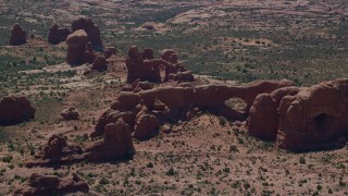 AX137_075 - 6K stock footage aerial video of North Window, South Window, Turret Arch rock formations, Arches National Park, Utah