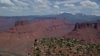 AX137_085 - 6K stock footage aerial video of buttes and mesas seen from Dry Mesa in Moab, Utah