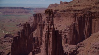 AX137_104 - 6K stock footage aerial video of orbiting The Titan near other rock formations at Fisher Towers, Utah
