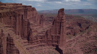 AX137_108 - 6K stock footage aerial video of approaching The Titan rock formation at Fisher Towers, Utah
