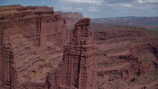 AX137_109 - 6K stock footage aerial video view of the top of The Titan rock formation at Fisher Towers, Utah