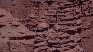 AX137_118 - 6K stock footage aerial video of an orbit of two rock climbers on tall formations at Fisher Towers, Utah