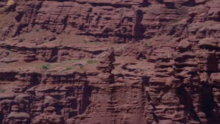 AX137_120 - 6K stock footage aerial video of a couple of rock climbers on a rock formation at Fisher Towers, Utah