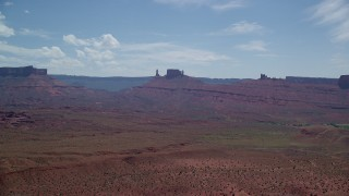 AX137_125 - 6K stock footage aerial video of distant desert buttes near Moab, Utah