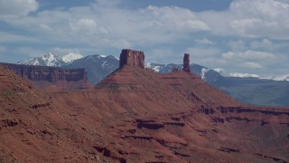 AX137_129 - 6K stock footage aerial video approach a butte by Castleton Tower in Moab, Utah