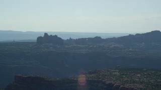 AX138_010 - 6K stock footage aerial video of desert buttes and and natural arches in Arches National Park, Utah