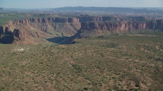 AX138_011 - 6K stock footage aerial video approach to Big Bend Canyon and the Colorado River in Arches National Park, Utah