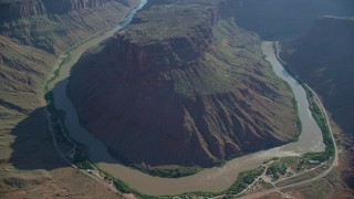 AX138_015 - 6K stock footage aerial video of Colorado River at bottom of Big Bend Canyon in Arches National Park, Utah