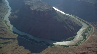 AX138_017 - 6K stock footage aerial video of a reverse view of Big Bend Canyon and Colorado River, Arches National Park, Utah