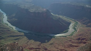 AX138_018 - 6K stock footage aerial video of flying away from Big Bend Canyon and Colorado River, Arches National Park, Utah