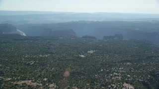 AX138_019 - 6K stock footage aerial video of a wide view of Big Bend Canyon in Arches National Park seen from flat desert, Utah