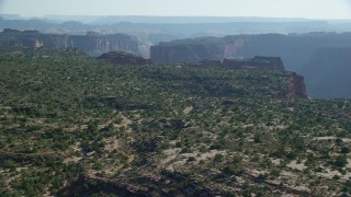 AX138_022 - 6K stock footage aerial video of approaching the edge of Big Bend canyon cliffs in Arches National Park, Utah