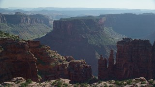 AX138_024 - 6K stock footage aerial video fly over cliff to reveal Colorado River and Big Bend, Arches National Park, Utah