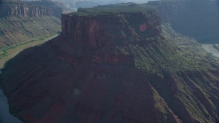 AX138_025 - 6K stock footage aerial video fly over Big Bend and Colorado River toward cliffs, Arches National Park, Utah