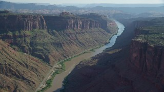 AX138_026 - 6K stock footage aerial video of the Colorado River and state road in Big Bend, Arches National Park, Utah