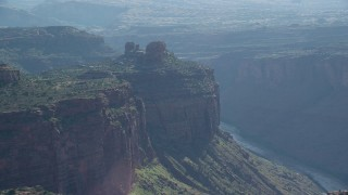 AX138_029 - 6K stock footage aerial video of cliff top buttes overlooking Colorado River, Arches National Park, Utah