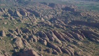 AX138_034 - 6K stock footage aerial video of petrified sand dunes with hiking and biking trails, Sand Flats Recreation Area, Moab, Utah