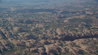 AX138_039 - 6K stock footage aerial video of a view of petrified sand dune rock formations at Sand Flats Recreation Area, Utah