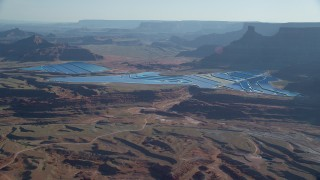 AX138_057 - 6K stock footage aerial video of blue potash ponds in the desert, Moab, Utah