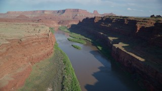 AX138_085 - 6K stock footage aerial video flight over Colorado River River in Goose Neck area of Meander Canyon, Canyonlands National Park, Utah