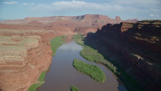 AX138_086 - 6K stock footage aerial video of a flight though Goose Neck area, Meander Canyon, following the river, Canyonlands National Park, Utah