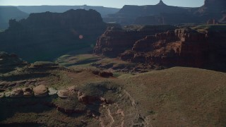 AX138_089 - 6K stock footage aerial video fly over Meander Canyon to reveal Colorado River, Canyonlands National Park, Utah