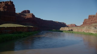AX138_100 - 6K stock footage aerial video fly through Meander Canyon, follow Colorado River to shady area, Canyonlands National Park, Utah