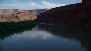 AX138_106 - 6K stock footage aerial video fly low through shady canyon, and over the Colorado River, Canyonlands National Park, Utah