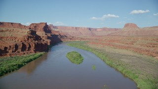 AX138_107 - 6K stock footage aerial video fly low through Meander Canyon over Colorado River, Canyonlands National Park, Utah