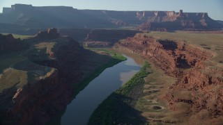AX138_111 - 6K stock footage aerial video of the Colorado River and Meander Canyon near buttes and mesas, Canyonlands National Park, Utah