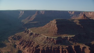 AX138_117 - 6K stock footage aerial video of mesas and buttes seen across Shafer Canyon in Canyonlands National Park, Utah