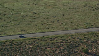 AX138_122 - 6K stock footage aerial video of tracking a dark sedan on Grand View Point Road in Canyonlands National Park, Utah