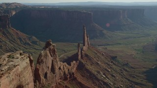 AX138_136 - 6K stock footage aerial video approach the Zeus and Moses Butte in Canyonlands National Park, Utah