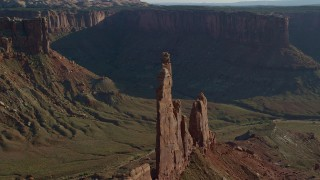 AX138_137 - 6K stock footage aerial video flyby Zeus and Moses Butte in Taylor Canyon, Canyonlands National Park, Utah