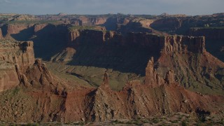 AX138_141 - 6K stock footage aerial video of the Zeus and Moses Butte in Taylor Canyon, Canyonlands National Park, Utah