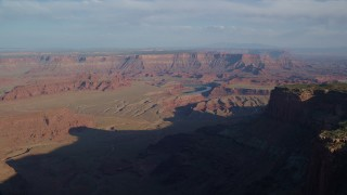 AX138_154 - 6K stock footage aerial video approach buttes and mesas around Meander Canyon, Canyonlands National Park, Utah
