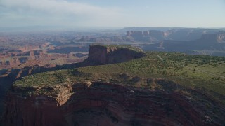 AX138_155 - 6K stock footage aerial video of the Dead Horse Point Overlook, with Canyonlands National Park in the background, Utah