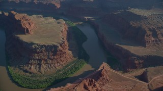 AX138_159 - 6K stock footage aerial video fly over Meander Canyon's Goose Neck in Canyonlands National Park, Utah