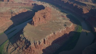 AX138_160 - 6K stock footage aerial video of Colorado River through Meander Canyon's Goose Neck in Canyonlands National Park, Utah
