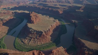 AX138_164 - 6K stock footage aerial video of passing the Colorado River in the Goose Neck of Meander Canyon, Canyonlands National Park, Utah