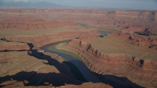 AX138_166 - 6K stock footage aerial video a slow approach to Meander Canyon and the Colorado River in Moab, Utah