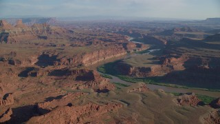 AX138_168 - 6K stock footage aerial video of Colorado River and Meander Canyon by mesas in Moab, Utah