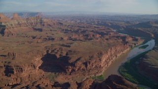 AX138_170 - 6K stock footage aerial video of Colorado River through Meander Canyon and side canyons in Moab, Utah